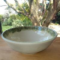 Earthstone bowl with green and yellow slip