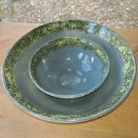 Larger and smaller stoneware and slip bowls