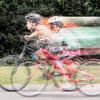 Moving portrait of children cycling - bicycles, helmets