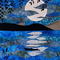 Quilted Moonscape using layered batiks with applique and free-motion embroidery
