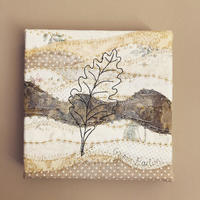 Free-motion oak leaf on quilted background wrapped around canvas