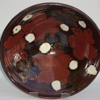 Large thrown stoneware bowl with red flowers