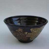 Wheel-thrown brown bowl decorated with white flowers