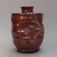 Handmade, thrown and distorted container with lid