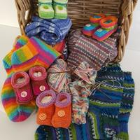 Collection of knitted socks and baby booties