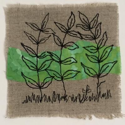 free motion embroidery over batik on hessian