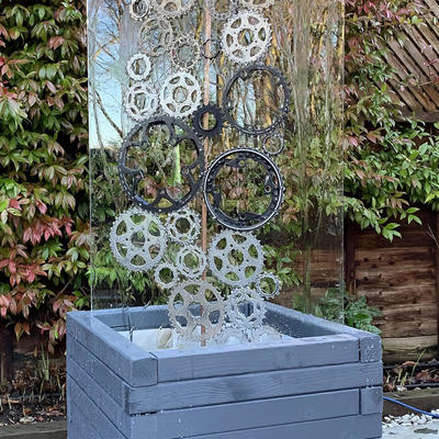 Cogs in the machine. Sculpture, water feature, fountain