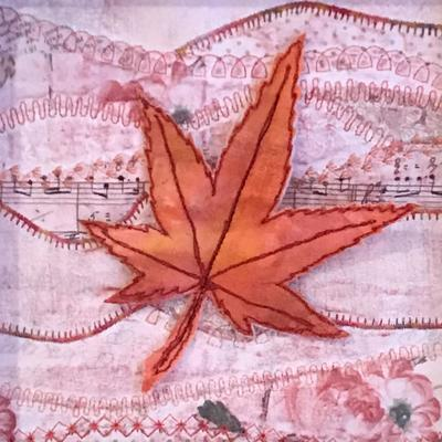 "Floating free-motion quilted maple leaf 'hovering' over a quilted patchwork background. Mounted in 8""x8"" deep box frame"
