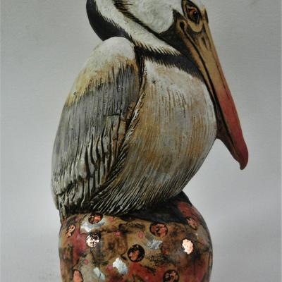 Pelican, stoneware with applied slips and silver leaf