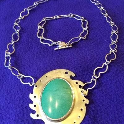 Adventurine stone in a setting and chain to reflect to the sea. Matching bracelet.