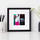 Small pink, black and white mixed media painting in a square frame