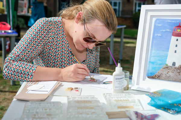 Catherine Henshaw working on a piece of glass painting