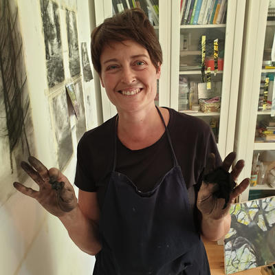 Artist Liz Cotgreave working on a series of charcoal drawings in her studio
