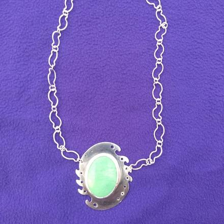 Crysocolla cabochon in wave-form setting with hand-formed chain.