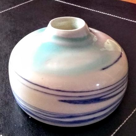 Thrown porcelain vessel with cobalt streaks and transparent and blue glaze.