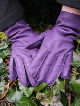 Image shows an example of a pair of hand stitched leather gloves.