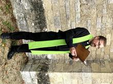 Image shows model wearing a green vicar's stole to advertise the course.
