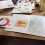 Examples of students work on Intro to paint and draw workshops